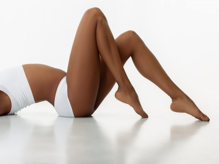 Perfectly slim tanned woman